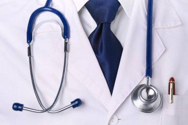 Medical doctor with a stethoscope standing in office