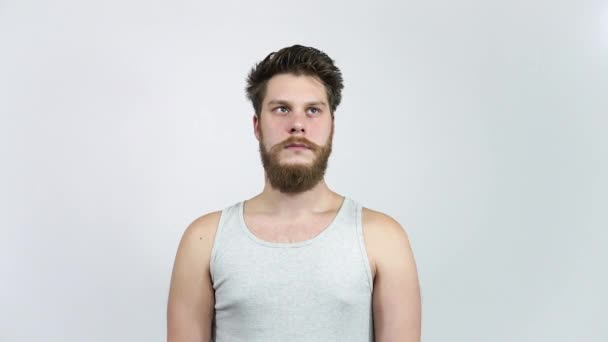 Frustrated man looking at the camera.A young guy with a beard in depression.