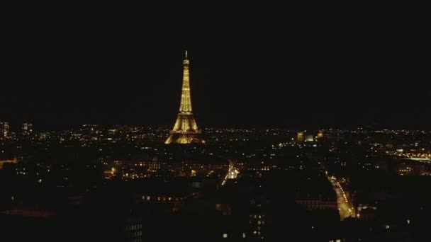 AERIAL: View over Paris, France at Night with View on Eiffel Tower, Tour Eiffel Shining light and Beautiful City Lights