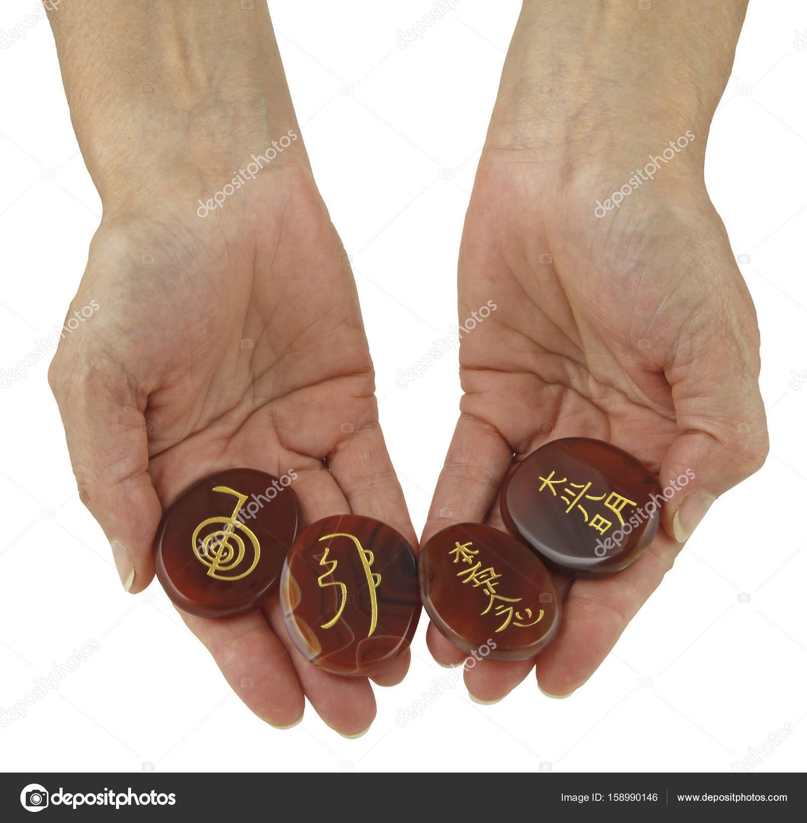 Reiki symbols etched onto polished carnelian stones stock photo reiki symbols etched onto polished carnelian stones stock photo buycottarizona Images