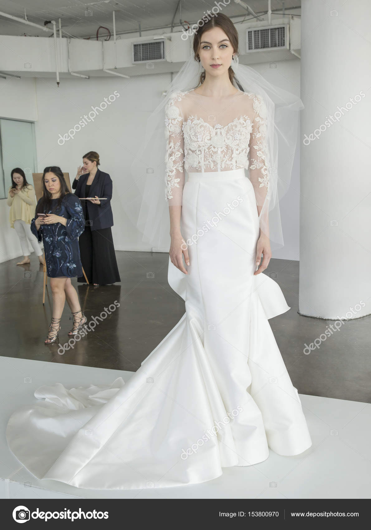 5c3e2a47 NEW YORK, NY - April 20, 2017: A model poses during presentation for the Marchesa  Bridal Spring 2018 Collection Runway Show during NY Fashion Week Bridal ...