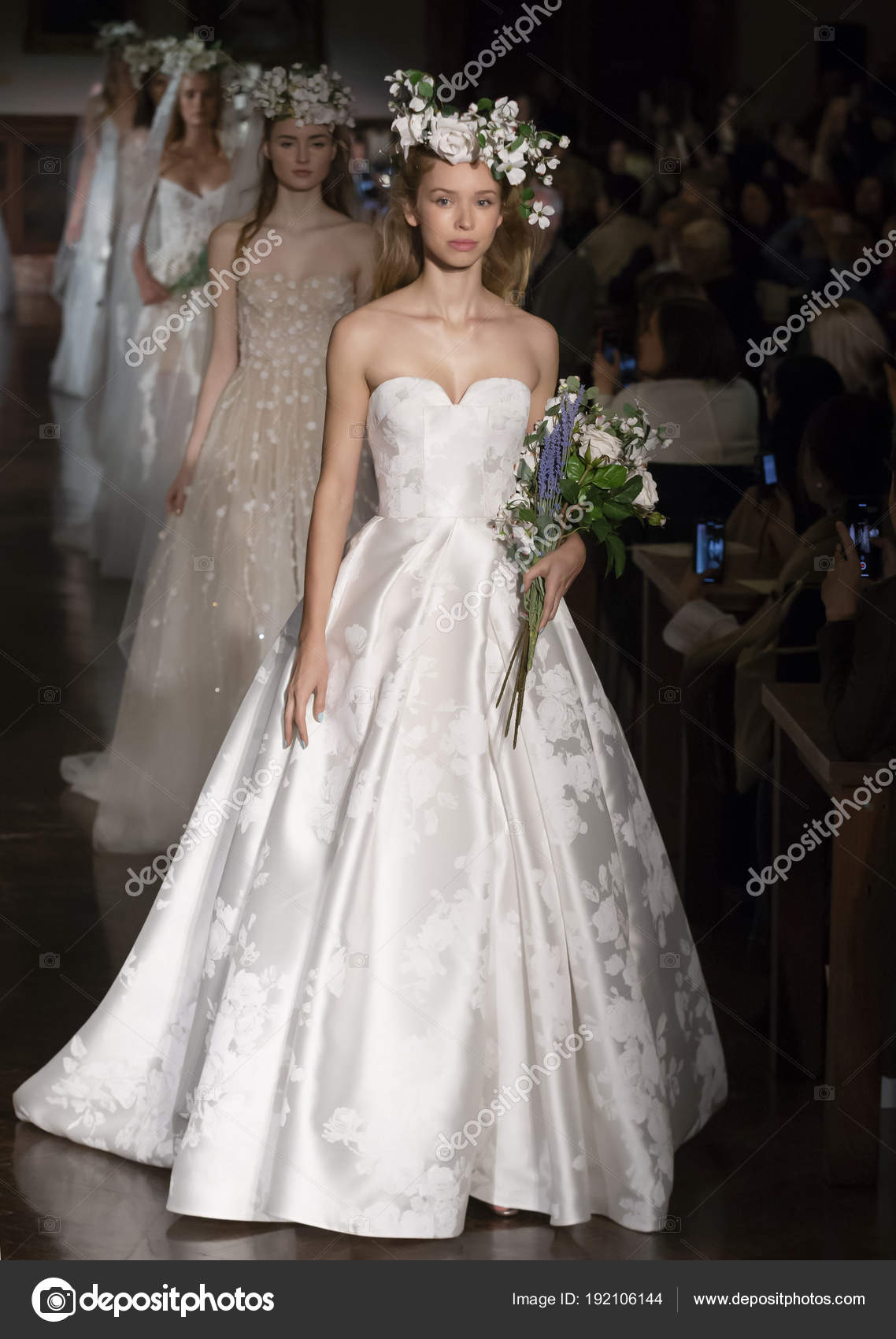 b010167f2c50 NEW YORK, NY - April 12, 2018: Models walk the runway at the Reem Acra  Bridal Spring 2019 Collection Runway Show during NY Fashion Week Bridal —  Photo by ...