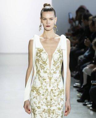 New York, New York - Feb. 08, 2020: Magdalena Chachlica walks the runway at Badgley Mischka Fall Winter 2020 Fashion Show