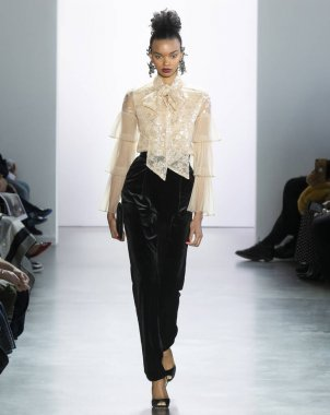 New York, New York - Feb. 08, 2020: Djenice Duarte Silva walks the runway at Badgley Mischka Fall Winter 2020 Fashion Show