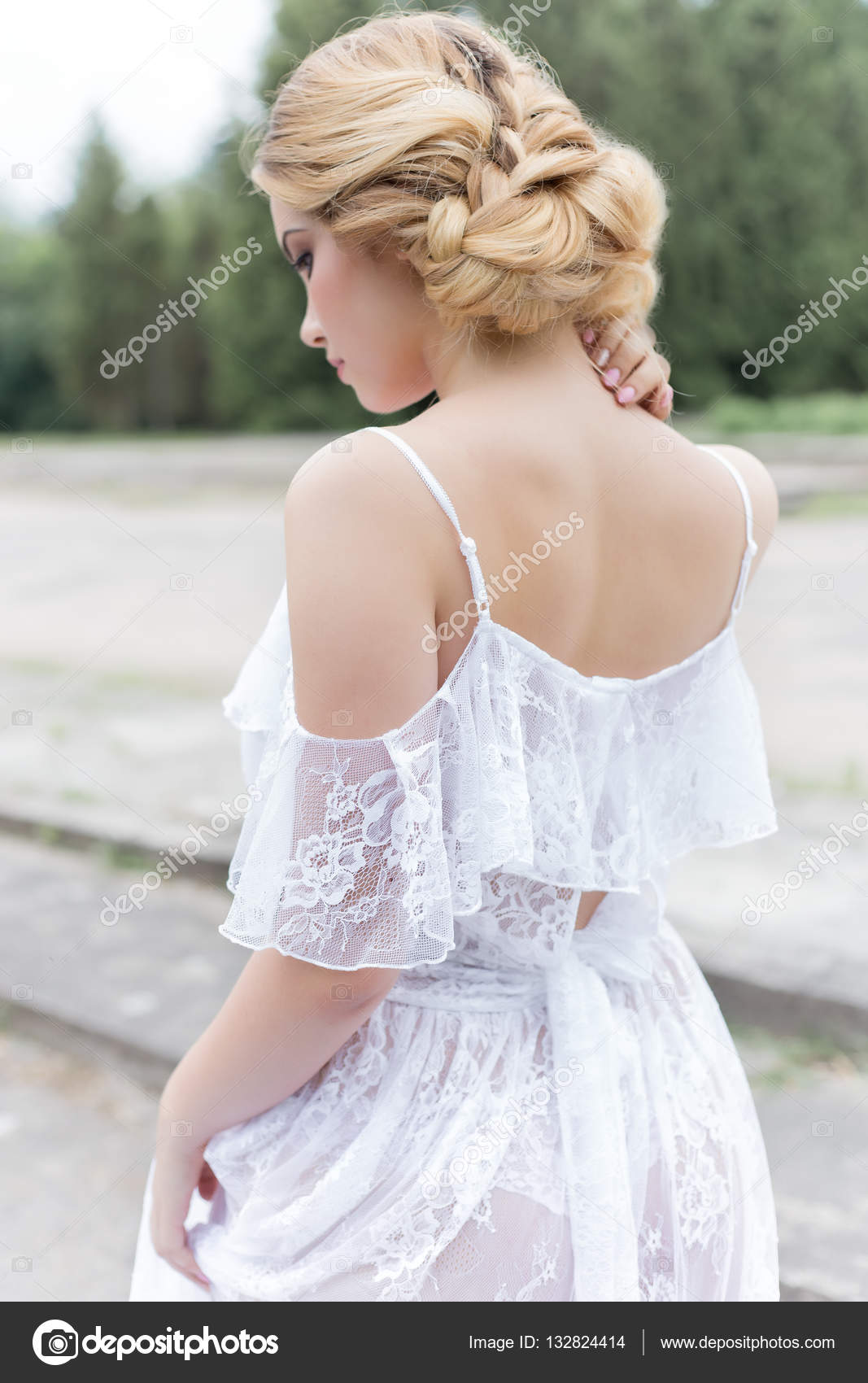 Beautiful Young Sweet Blonde Girl With A Wedding Bouquet In The Hands Of The Boudoir In A White Dress With Evening Hairstyle Walks Near The Ruins Photo By