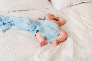 baby newborn in diaper, sleeping