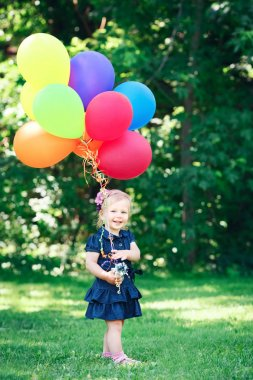 child girl  with colorful balloons