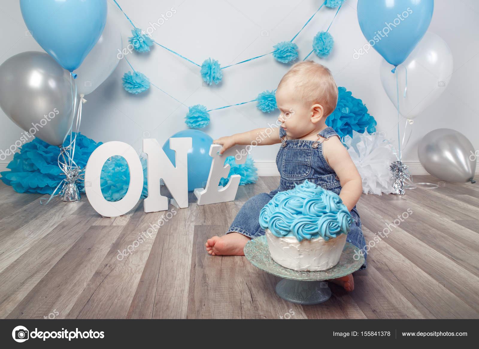 baby boy celebrating his first birthday stock photo