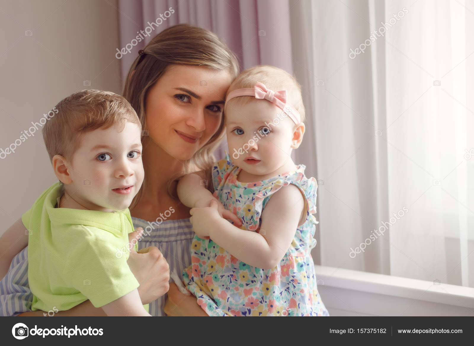 woman mother hugging two cute children — stock photo
