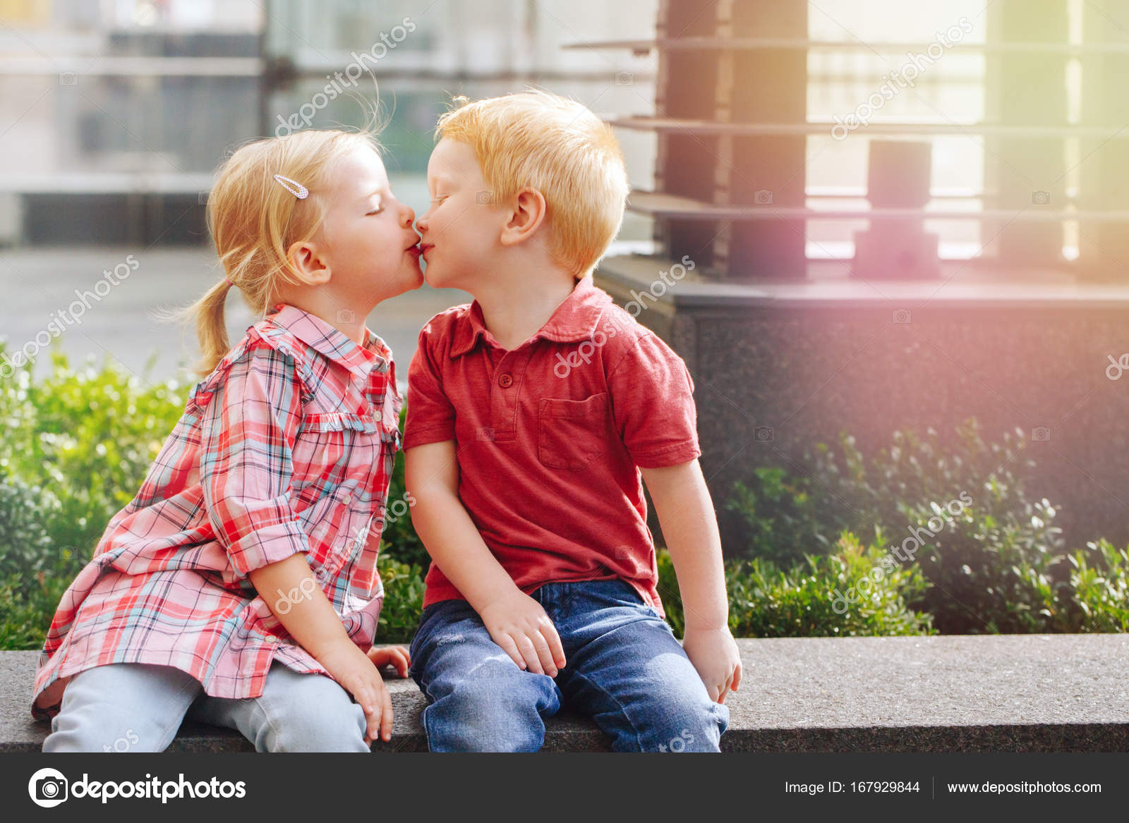 a boy and girl kissing each other