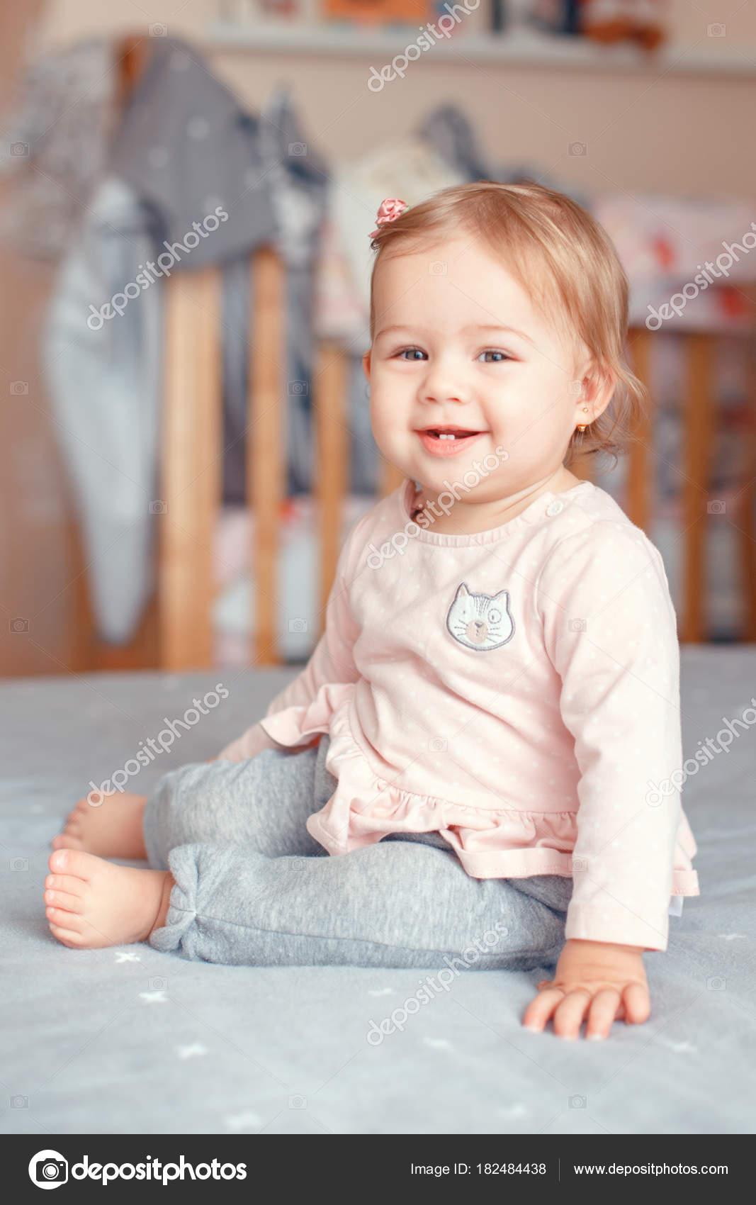 portrait cute adorable caucasian blonde smiling baby girl blue eyes