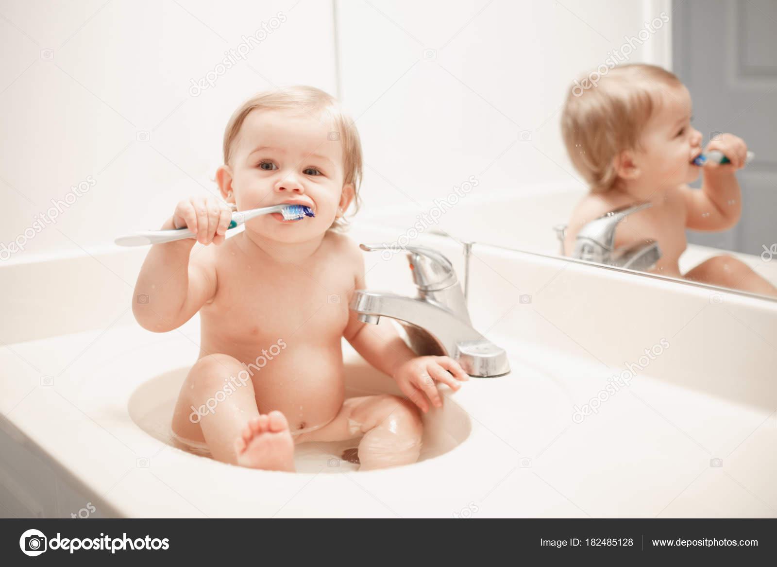 Portrait Cute Caucasian Blonde Funny Baby Girl Boy Sitting Washroom