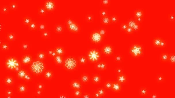 Vánoce a nový rok animace. Zlatý vánoční vločky na červeném pozadí. Velké sněhové vločky padající