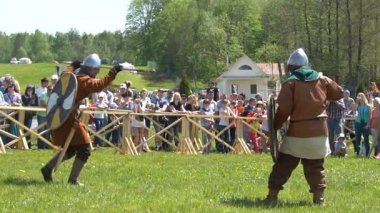 Minsk, Belarus - May 13, 2017: Festival of military historical reconstruction. The Battle of the Vikings. Slow motion.