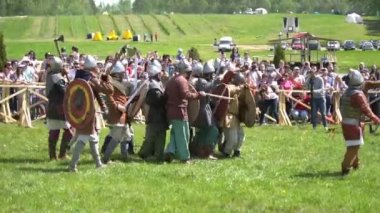 Minsk, Belarus - May 13, 2017: Festival of military historical reconstruction. Vikings storming fortification.