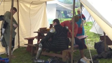 Minsk, Belarus - May 13, 2017: Festival of military historical reconstruction. Knights putting on armor before the battle.