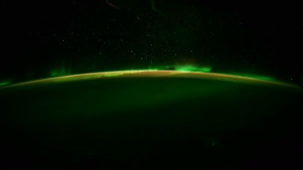 Earth and Aurora Borealis from ISS. Elements of this video furnished by NASA. 8K Timelapse