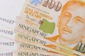 Zblízka hromadu peněz Singapur a pozadí textury nebo vzorku