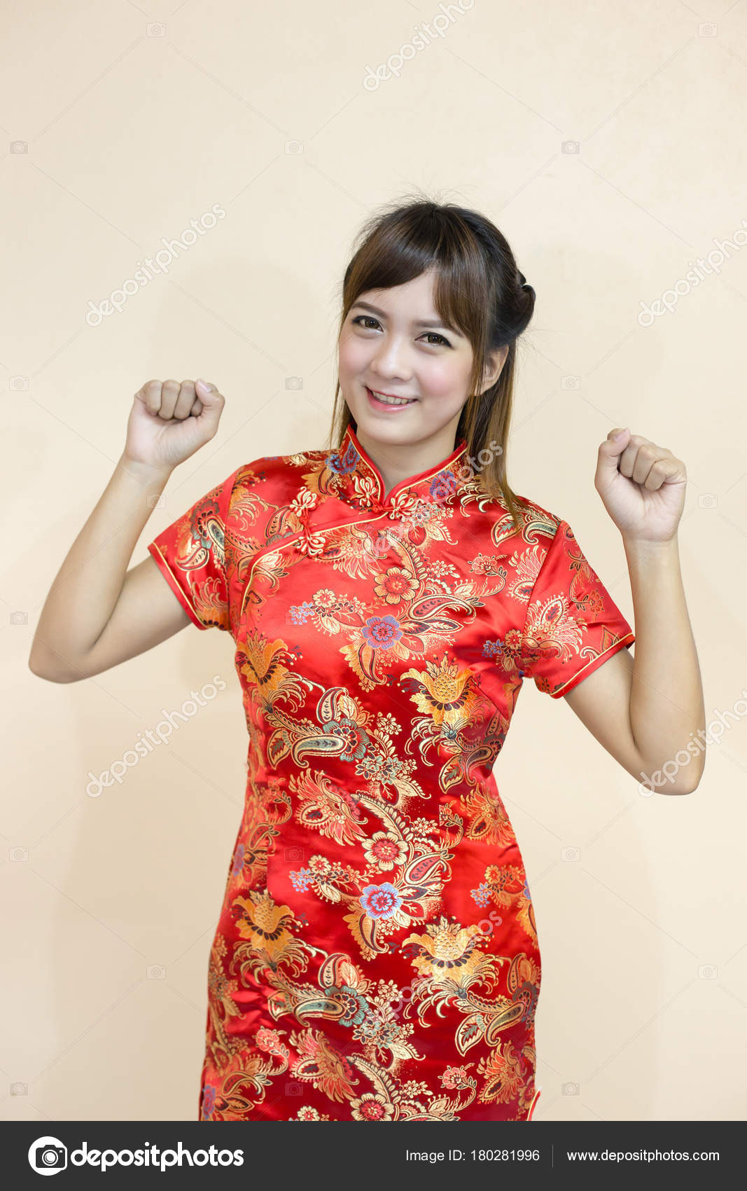 Asian woman greeting traditional chinese cheongsam hand lift welcome asian woman greeting in traditional chinese or cheongsam with hand lift welcome expression and lucky and gleeful in chinese new year celebration in red m4hsunfo