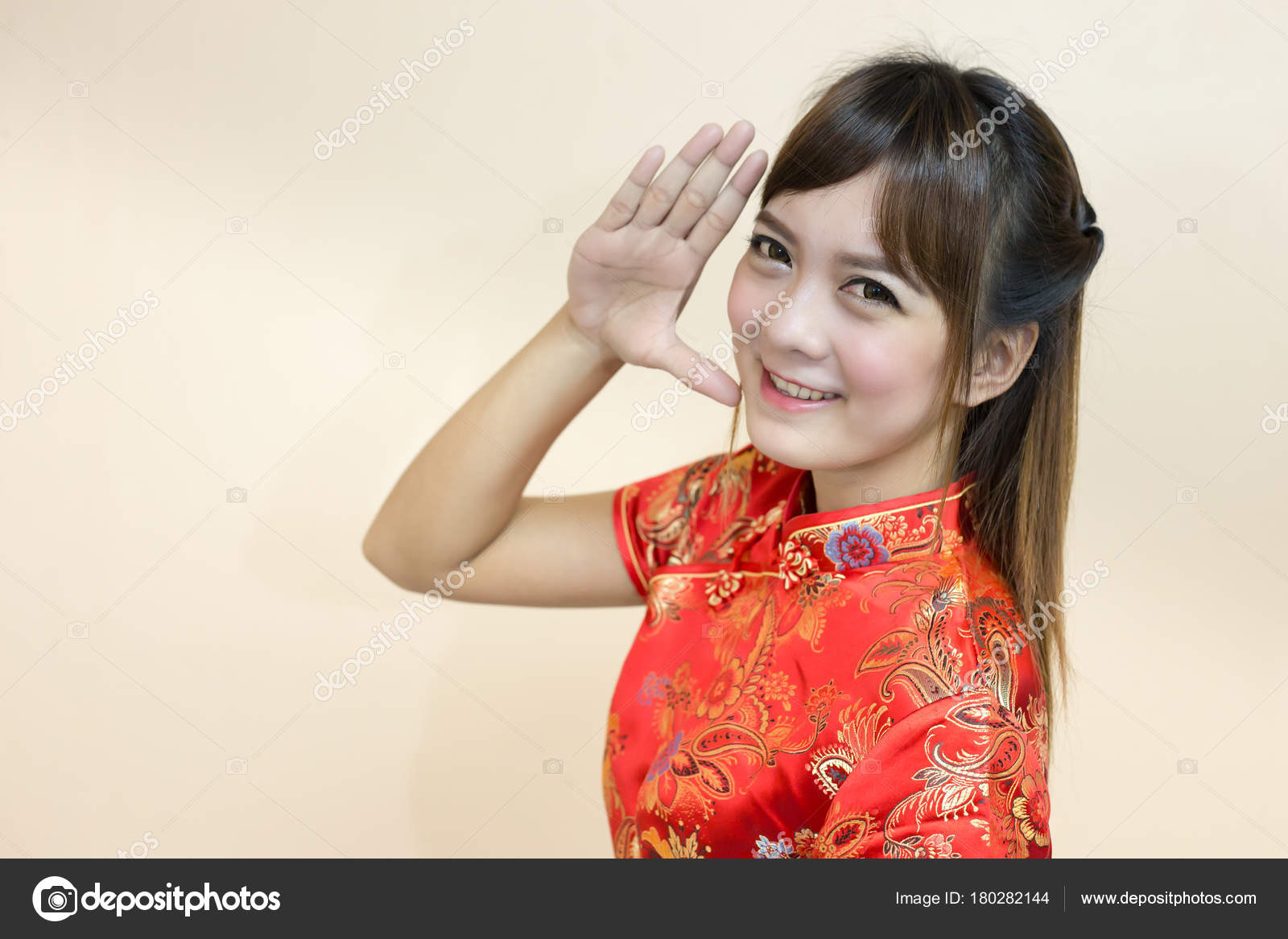 Asian woman greeting traditional chinese cheongsam hand lift welcome asian woman greeting in traditional chinese or cheongsam with hand lift welcome expression and lucky and enjoy in chinese new year celebration in red golden m4hsunfo