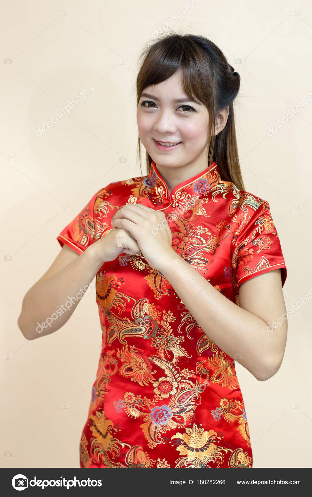 Asian woman greeting traditional chinese cheongsam hand lift welcome asian woman greeting in traditional chinese or cheongsam with hand lift welcome expression and lucky in chinese new year celebration in red golden style m4hsunfo