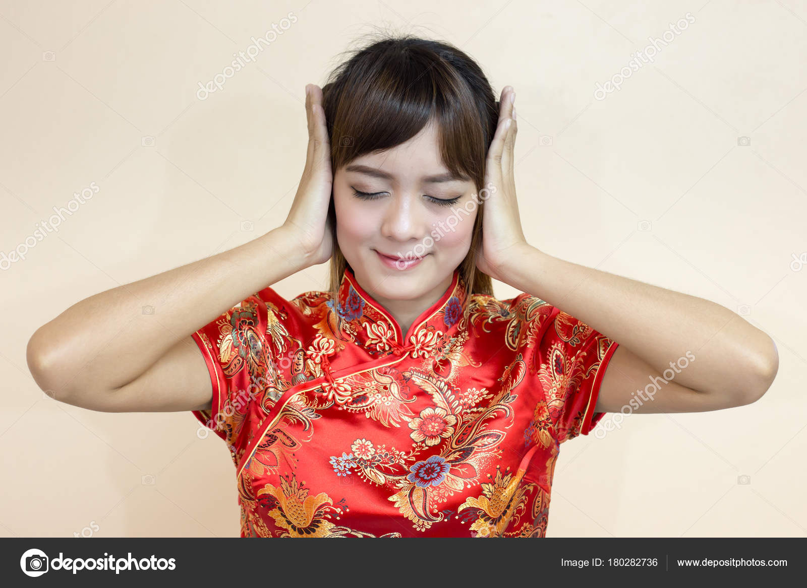 Asian woman greeting traditional chinese cheongsam hands stock asian woman greeting in traditional chinese or cheongsam with hands off photo by powerbee photo m4hsunfo