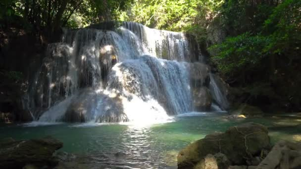 Waterfall in deep forest at Huay Mae Kamin Waterfall The beautiful and famous in Khuean Srinagarindra National Park Kanchanaburi province, Thailand. Slow motion 120 FPS