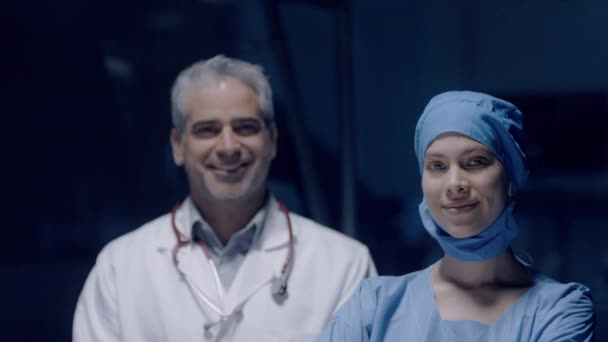 Portrait of smiling male and female doctors satisfied after successful surgery. Concept of medicine, health care and people, medical, hospital.