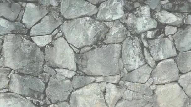 Animovaná textura z hrubých kamenů, dlažebních kostek, odštípané skály. Kamenná textura dekorativní vzory. Abstrakce meditace zisk energie.
