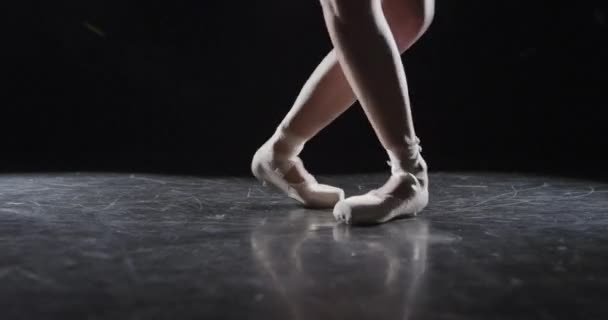 Ballet performer in dark studio