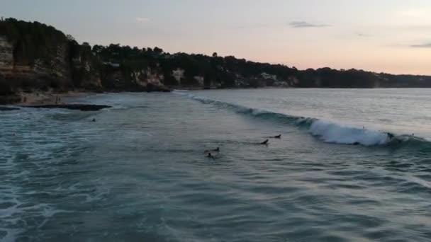 surfers ride big waves Dreamland beach bali indonesia