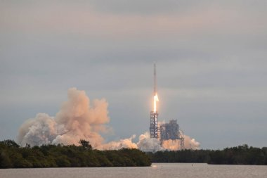 CAPE CANAVERAL, FL - FEB 19, 2017: SpaceX debuts Falcon 9 launch from 39A with CRS-10 Dragon mission. Falcon 9 is a two-stage rocket designed and manufactured by SpaceX