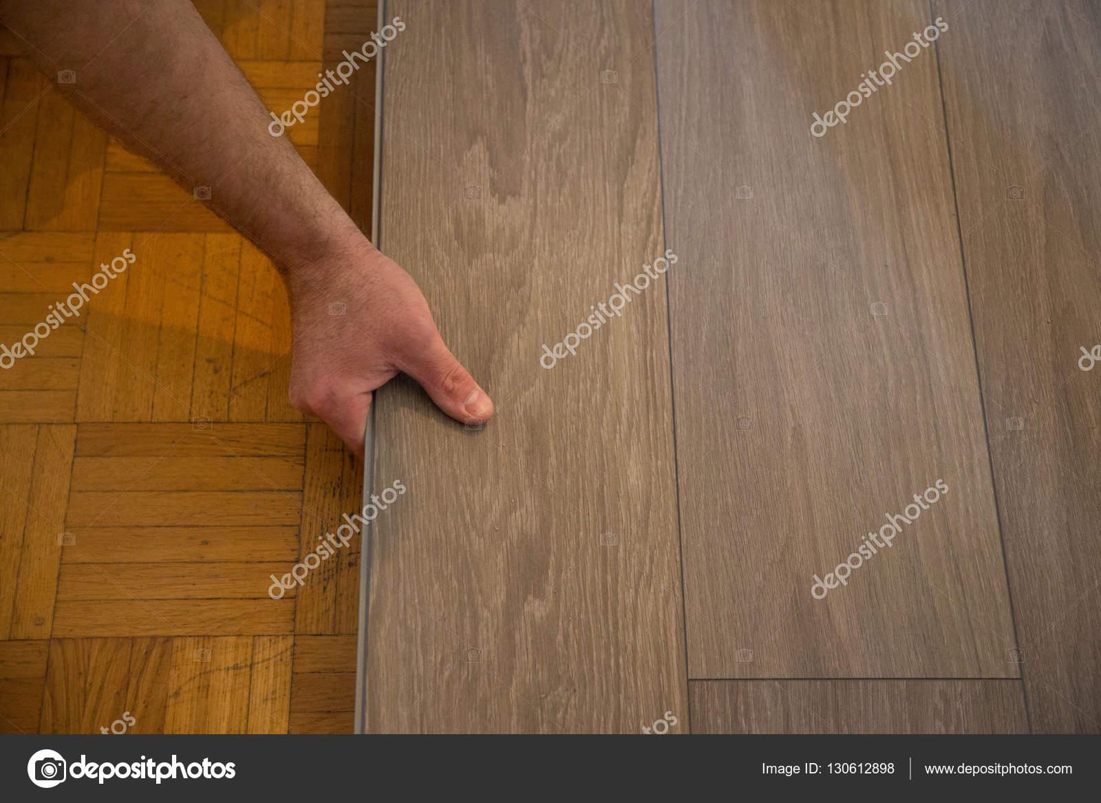 vinylboden auf parkett verlegen — stockfoto © munich1 #130612898