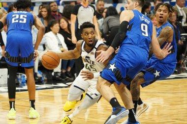 Utah Jazz's Donavan MItchell (#45) runs pass Orlando's Nikola Vucevic (#9) I (Amway Center in Orlando on Friday January 4, 2020) Photo Credit:  Marty Jean-Louis