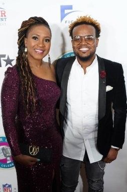 Gospel Singer Travis Greene and his wife Jacqueline Gyamfi Greene walk the red carpet during the 21st Annual Super bowl Gospel Celebration Red Carpet at the James L Knight Center in Miami Florida on Thursday January 30, 2020.  Photo Credit:  Marty Je