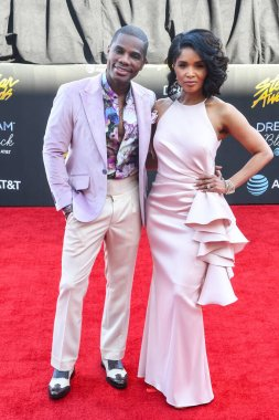 Kirk Franklin and his wife Tammy Collins walk the red carpet during the 34th annual Stellar Awards in Las Vegas Nevada on March 29, 2019.  Photo Credit:  Marty Jean-Louis