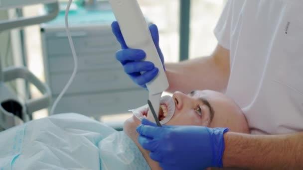 Dentist scanning patients teeth