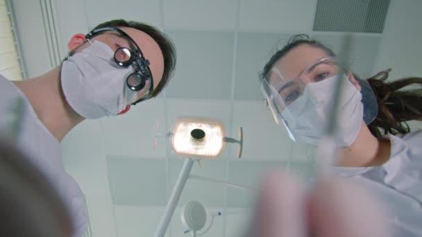 Dentist and nurse at work