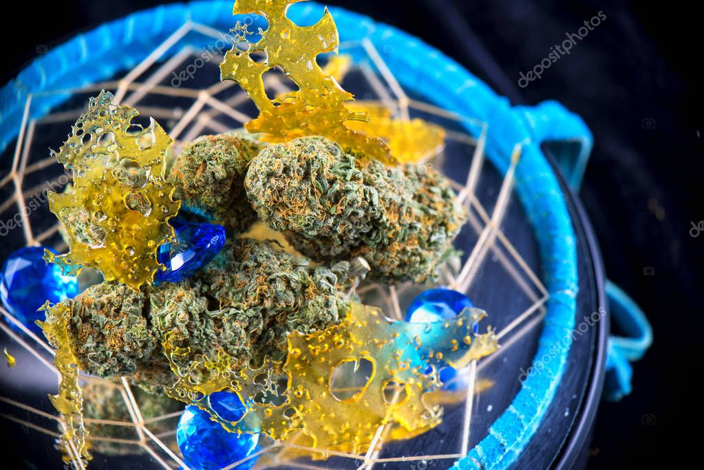 Macro detail of cannabis nugs and marijuana concentrates (aka sh