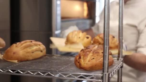 the baker prepares the bread for baking