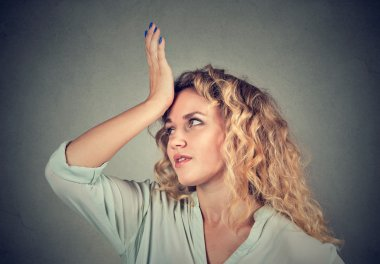 Regrets wrong. Woman slapping hand on head duh moment