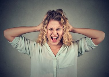 Stressed angry woman yelling screaming has temper tantrum