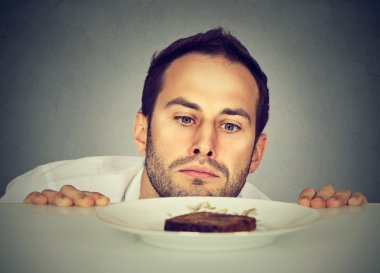 Hungry man craving sweet food