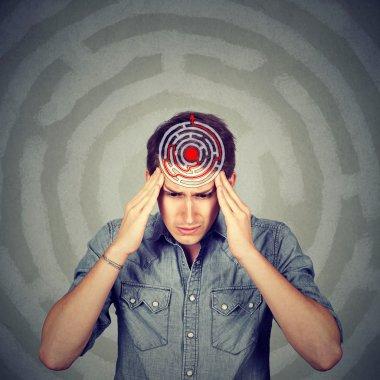 Problem solution concept. Young man solving puzzle