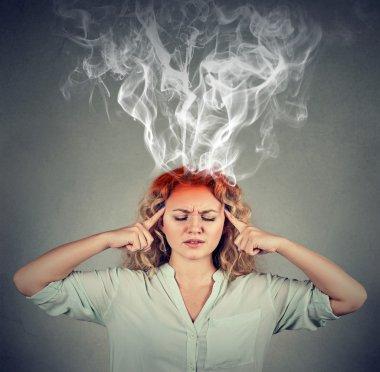 Woman thinks very intensely having headache