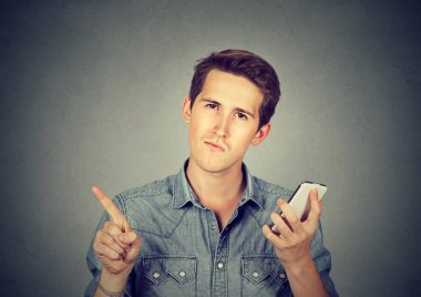 man with cell phone showing no, don't, attention with finger gesture