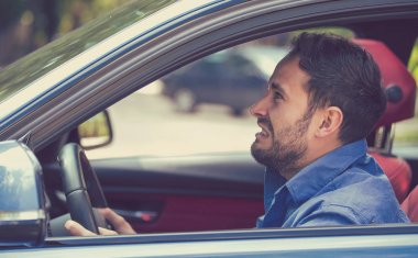 Side profile angry driver. Negative human emotions face expressio
