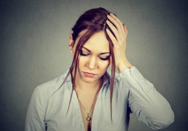 sad desperate woman with worried stressed face expression looking down