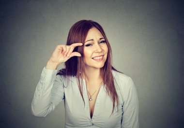 Woman showing small amount size gesture with fingers