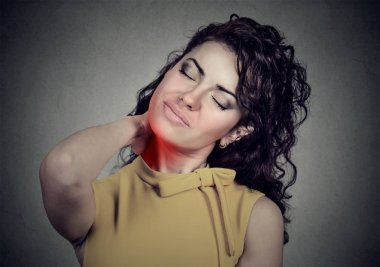 Back and spine disease. Woman massaging painful neck